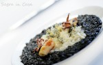 Black and white Risotto, using ink squid and a 24 month matured parmesan  cheese  for creamy risotto served with calamari and a waffle crispy parmesan.